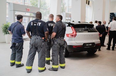 Fire fighters with the donated all-electric XC40 Recharge at Manhattan Volvo located at 565 11th Avenue in New York City.