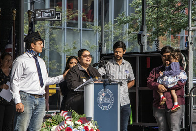 Dandai Moreno, wife of NYPD Detective George Moreno, who passed away on July 30, 2021, from 9/11 related cancer, speaks alongside her five children at the Tunnel to Towers 9/11 Illness Memorial Ceremony