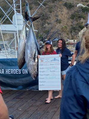 Veterans Mea Peterson and Vanessa Brown pose with their qualifying bluefin tuna. Peterson's weighed 101 lbs. and Brown's weighed 156 lbs. Their catch was celebrated during a post-tournament weigh-in on Avalon's iconic Green Pleasure Pier.