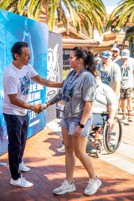 Veteran Vanessa Brown is greeted by WHOW Tournament Founder and loanDepot Founder and CEO Anthony Hsieh. The 2021 WHOW tournament is the first WHOW event that included two all-female combat-wounded teams.